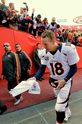 Denver Broncos quarterback Peyton Manning leaves the field after an NFL football game against theKansas City Chiefs Sunday, Nov. 25, 2012, in Kansas City, Mo. The Broncos won the game 17-9. (AP Photo/Charlie Riedel) Photo: Charlie Riedel, ASSOCIATED PRESS / AP2012