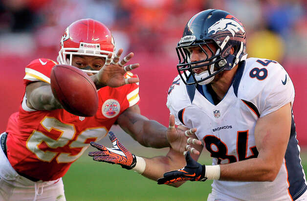 Kansas City Chiefs strong safety Eric Berry (29) breaks up a pass intended for Denver Broncos tight end Jacob Tamme (84) during the second half of an NFL football game on Sunday, Nov. 25, 2012, in Kansas City, Mo. The Broncos won the game 17-9. (AP Photo/Charlie Riedel) Photo: Charlie Riedel, ASSOCIATED PRESS / AP2012
