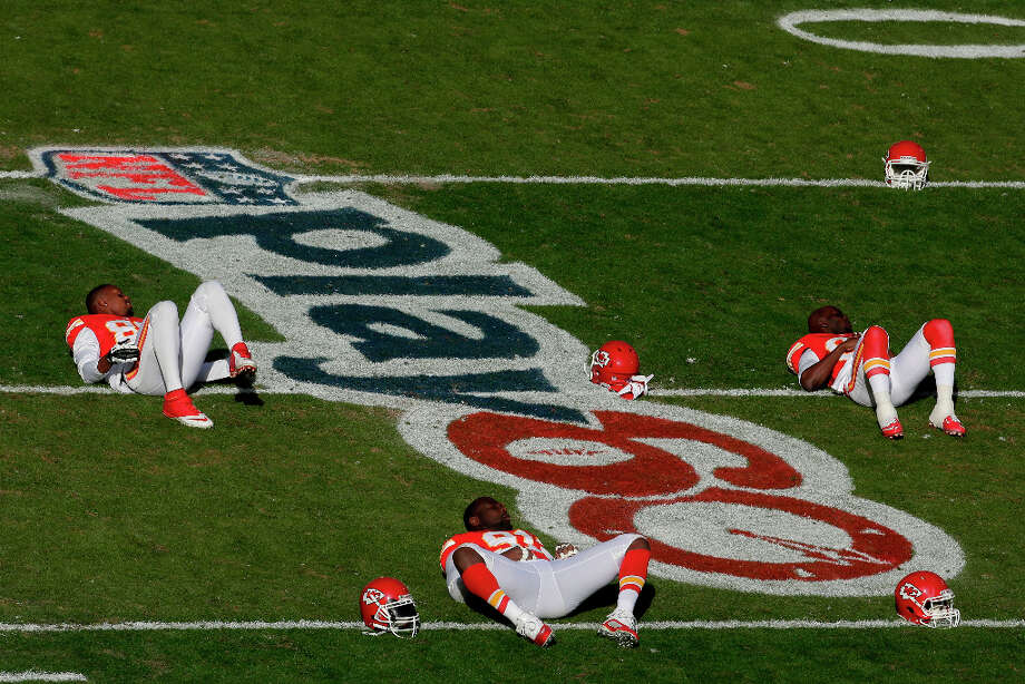 Kansas City Chiefs players stretch on a play60 logo before an NFL football game against the Denver Broncos  Sunday, Nov. 25, 2012, in Kansas City, Mo. (AP Photo/Charlie Riedel) Photo: Charlie Riedel, ASSOCIATED PRESS / AP2012