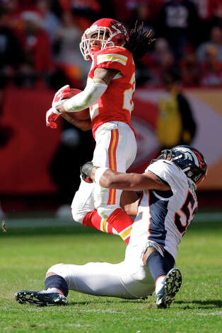 Kansas City Chiefs wide receiver Dexter McCluster is tackled by Denver Broncos outside linebacker Wesley Woodyard during the first half an NFL football game Sunday, Nov. 25, 2012, in Kansas City, Mo. (AP Photo/Charlie Riedel) Photo: Charlie Riedel, ASSOCIATED PRESS / AP2012