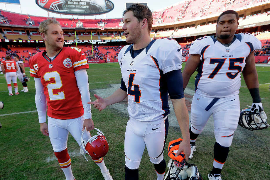 Kansas City Chiefs punter Dustin Colquitt (2) and Denver Broncos punter Britton Colquitt (4) talk after playing each other in an NFL football game Sunday, Nov. 25, 2012, in Kansas City, Mo. The Broncos won the game 17-9. (AP Photo/Charlie Riedel) Photo: Charlie Riedel, ASSOCIATED PRESS / AP2012