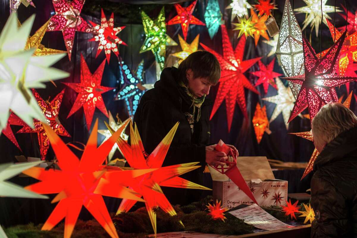 A vendor sells Christmas stars on the first day of the Christmas Market near the city hall in Berlin, Monday, Nov. 26, 2012.