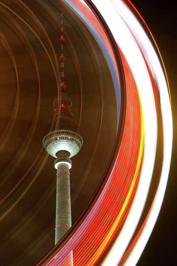 Picture taken with long exposure time shows one of Berlin's landmarks, the tv tower behind a big wheel on a christmas market in Berlin, on November 26, 2012.The market opens its doors from November 26 to December 31, 2012. AFP PHOTO / MARC TIRL   GERMANY OUTMARC TIRL/AFP/Getty Images Photo: MARC TIRL, AFP/Getty Images / DPA