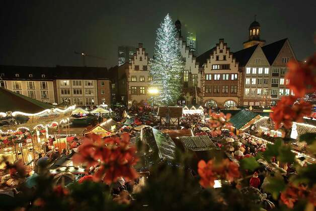 FRANKFURT, GERMANY - NOVEMBER 26:  The annual Christmas market is illuminated in the city center on its opening day on November 26, 2012 in Frankfurt, Germany. Christmas markets, with their stalls selling mulled wine, Christmas tree decorations and other delights, are an integral part of German Christmas tradition, and many of them opened across Germany today. Photo: Hannelore Foerster, Getty Images / 2012 Getty Images