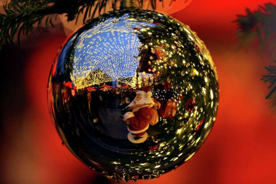 A christmas market scenery is reflected in a christmas ball in Cologne, western Germany, on November