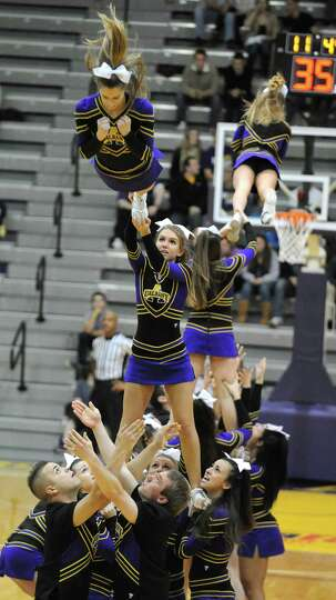 UAlbany's cheerleaders perform during a media timeout at a basketball game against Wagner at the SEF