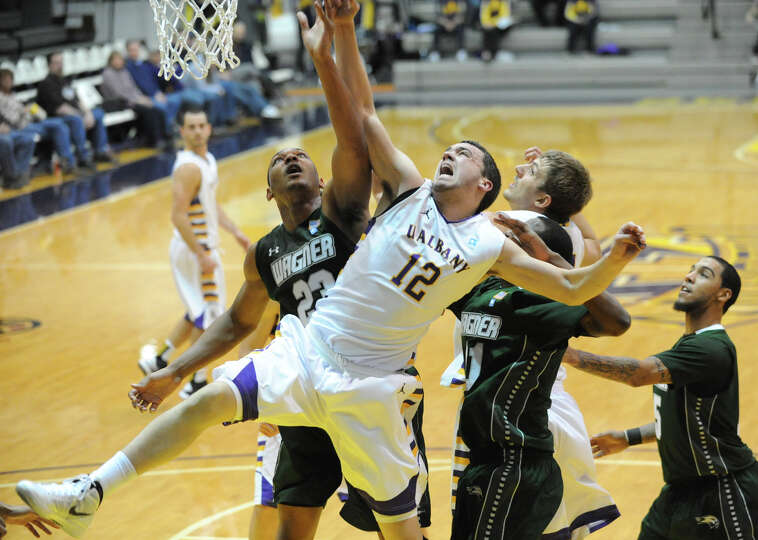 UAlbany's Peter Hooley, #12, tries to grab a rebound during a basketball game against Wagner at the