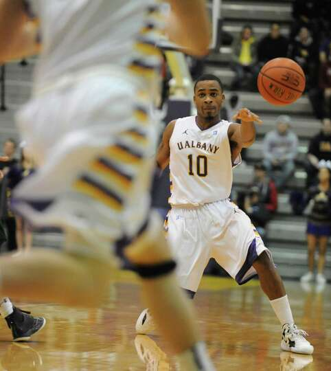 UAlbany's Mike Black passes the ball during a basketball game against Wagner at the SEFCU Arena Mond