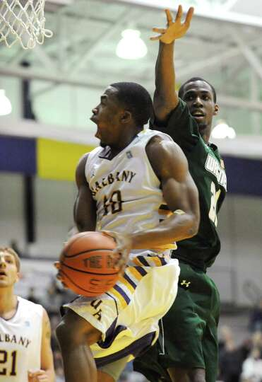 UAlbany's Mike Black drives to the basket during a basketball game against Wagner at the SEFCU Arena