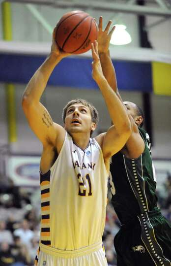 UAlbany's Blake Metcalf drives to the basket during a basketball game against Wagner at the SEFCU Ar