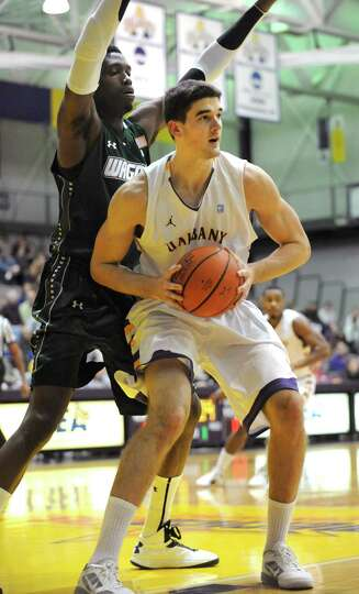UAlbany's John Puk tries to drive to the basket during a basketball game against Wagner at the SEFCU