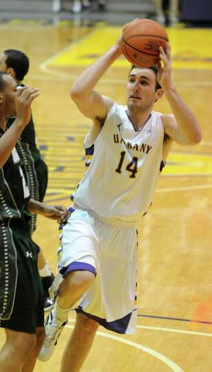 UAlbany's Sam Rowley drives to the basket during a basketball game against Wagner at the SEFCU Arena