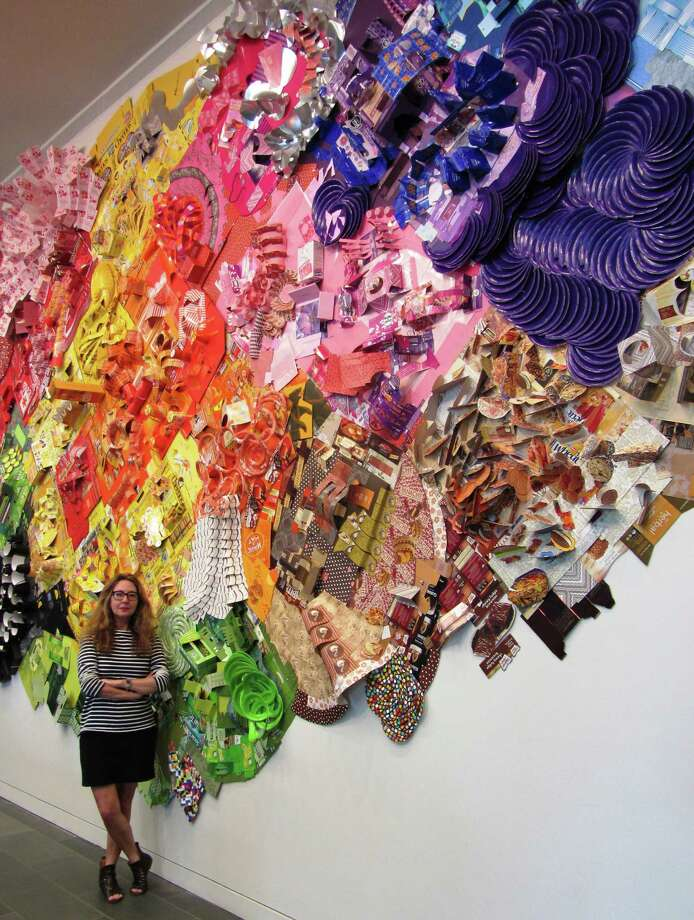 "New York artist Lisa Hoke spent three days installing ""The future ain't what it used to be"" at the McNay Art Museum. The sprawling piece is made of color coordinated product packaging and calls into question our society's consumer excess. Photo: Courtesy McNay Art Museum"