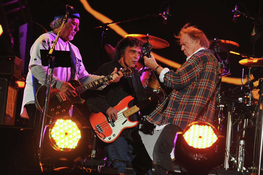 "NEW YORK, NY - SEPTEMBER 29:  Frank ""Poncho"" Sampedro, Billy Talbot and Neil Young of Neil Young and Crazy Hourse perform onstage at the Global Citizen Festival In Central Park To End Extreme Poverty - Show at Central Park on September 29, 2012 in New York City.  (Photo by Theo Wargo/Getty Images for the Global Citizen Festival) Photo: Theo Wargo, Getty Images For The Global Citi / 2012 Getty Images"