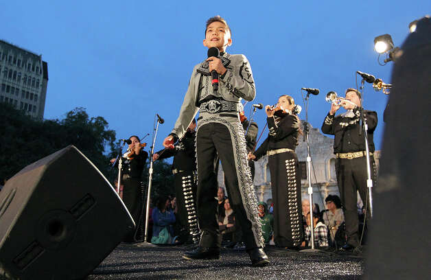 "Sebastian De La Cruz, 10, of ""America's Got Talent"" fame, sings at the Alamo Plaza H-E-B Tree Lighting Celebration Friday. De La Cruz is an alumnus of Network for Young Artists. Photo: Kin Man Hui, San Antonio Express-News / ©2012 San Antonio Express-News"