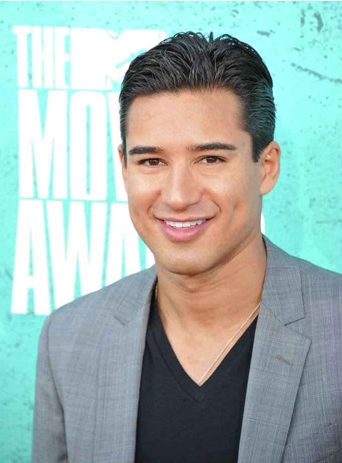 "Mario Lopez — A.C. Slater to ""Saved by the Bell"" fans — is 38, did a stint on ""Dancing With the Stars"" and is a correspondent on ""Extra."" Photo: JOE KLAMAR, AFP/Getty Images / 2012 AFP"