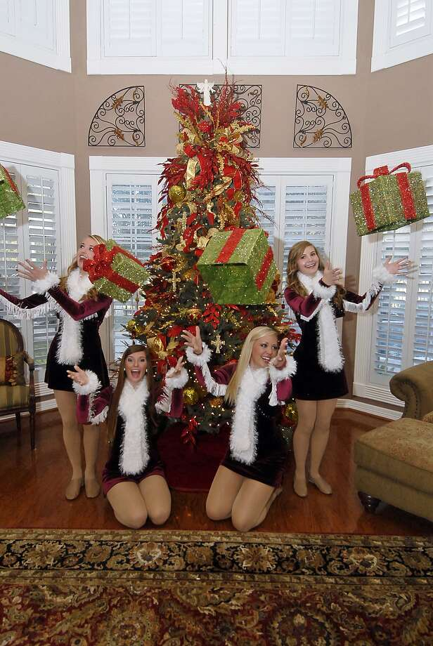 Cassidy Nessen, 17; Anna Peterson, 18; Courtney Christian, 18; and Jaclyn Heiser, 15 of the Cinco Ranch Cougar Stars are excited about Christmas decorations at the home of Caren Steffes.Cassidy Nessen, 17; Anna Peterson, 18; Courtney Christian, 18; and Jaclyn Heiser, 15 of the Cinco Ranch Cougar Stars are excited about Christmas decorations at the home of Caren Steffes. Photo:  Tony Bullard 2012, Freelance Photographer / © Tony Bullard & the Houston Chronicle