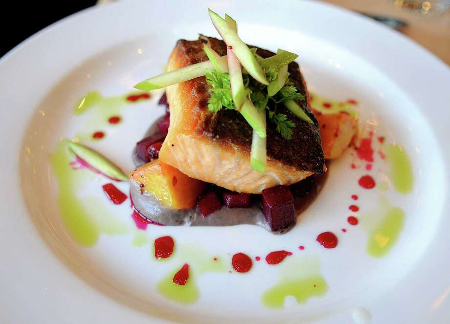 Pan roasted salmon with beet apple chutney and sunchoke puree at restaurant Harlan Social on Wednesday, November 14, 2012. Photo: Lindsay Niegelberg / Stamford Advocate