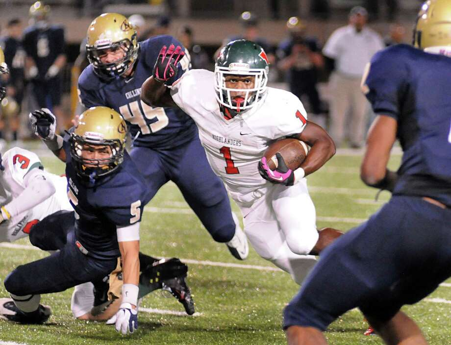 The Woodlands' Patrick Carr cuts past Klein Collins defenders Derrick Thomas, #5, and Christian Snow, #45, during The Woodlands at Klein Collins playoff football game at Klein Memorial Stadium. Photo by David Hopper Photo: David Hopper, Freelance / freelance