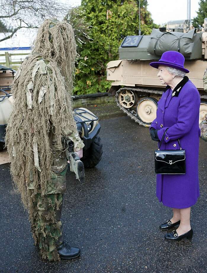 Oh, what a lovely sheepdog: Queen Elizabeth II meets a camouflaged sniper of the Household Cavalry at Combermere Barracks in Windsor, England. Photo: WPA Pool, Getty Images
