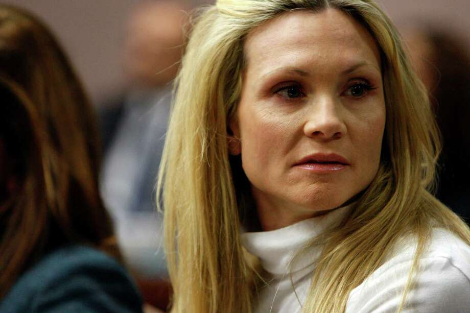 "Former ""Melrose Place"" actress Amy Locane-Bovenizer, 40, of Hopewell Township, N.J., looks to her husband and mother as the jury in her trial returns a verdict on Tuesday, Nov. 27, 2012 in Somerville, N.J.   The jurors convicted Locane-Bovenizer of vehicular homicide, but acquitted her of a more serious charge, aggravated manslaughter, in the 2010 accident that killed a 60-year-old woman. Somerset County prosecutors said Locane-Bovenizer's blood-alcohol level was nearly three times the legal limit when the crash occurred on a dark two-lane road in Montgomery Township. The defence conceded she was driving under the influence. But her lawyer claimed a woman was chasing her after an earlier accident, forcing her to speed.  (AP Photo/The Star-Ledger, Robert Sciarrino, Pool) Photo: Robert Sciarrino"