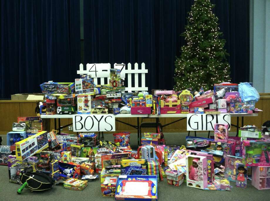 Interfaith Caring Ministries will conduct its annual Christmas toy giveaway, Dec. 11-12 and needs donations. These toys were collected during a prior drive. Photo: Courtesy