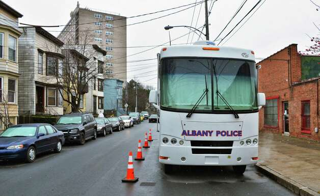 Albany police's mobile command van near 157 Myrtle Avenue in Albany Tuesday Nov. 27, 2012, where a man stabbed three women yesterday killing one. Police are searching for Michael D. Anderson, 29, of Albany, who police suspect is behind the stabbings.  (John Carl D'Annibale / Times Union) Photo: John Carl D'Annibale / 00020273A