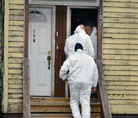 APD crime scene investigators enter 157 Myrtle Avenue in Albany Tuesday Nov. 27, 2012, where a man stabbed three women yesterday killing one. Police are searching for Michael D. Anderson, 29, of Albany, who police suspect is behind the stabbings.  (John Carl D'Annibale / Times Union) Photo: John Carl D'Annibale / 00020273A