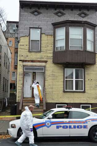 APD crime scene investigators at 157 Myrtle Avenue in Albany Tuesday Nov. 27, 2012, where a man stabbed three women yesterday killing one.  (John Carl D'Annibale / Times Union) Photo: John Carl D'Annibale / 00020273A