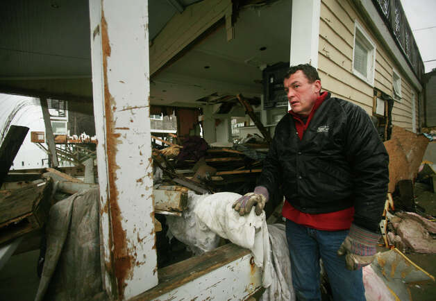 Jack Tetreau of Fairfield looks at one of the homes devastated by Hurricane Sandy on Fairfield Beach Road in Fairfield on Tuesday, November 27, 2012. Photo: Brian A. Pounds / Connecticut Post