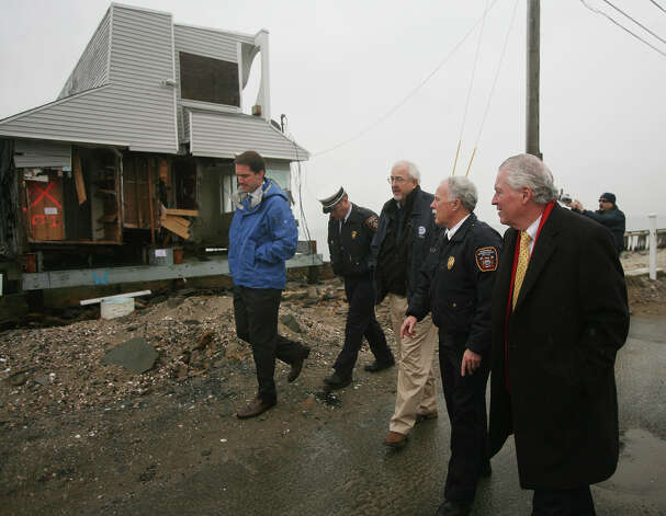 Congressman Jim Himes, left, tours Hurricane Sandy damage with FEMA Administrator Craig Fugate, center, Fairfield First Selectman Michael Tetreau, right, and Fairfield Fire Department officials on Fairfield Beach Road in Fairfield on Tuesday, November 27, 2012. Photo: Brian A. Pounds / Connecticut Post