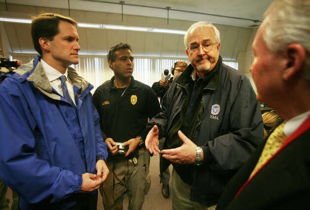 Congressman Jim Himes, left, FEMA Administrator Craig Fugate, second from right, and Fairfield First Selectman Michael Tetreau, right, at FEMA's Disaster Recovery Center at the Fairfield Senior Center on Tuesday, November 27, 2012. Photo: Brian A. Pounds / Connecticut Post