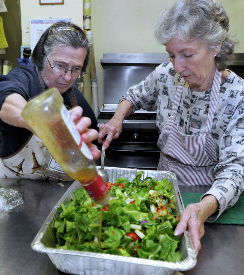 Rita Crimi, left, and Betty Ballard, both of Danbury, serve the afternoon meal at the Dorothy Day Hospitality House on Spring Street in Danbury, Tuesday, Nov. 27, 2012. Photo: Carol Kaliff / The News-Times