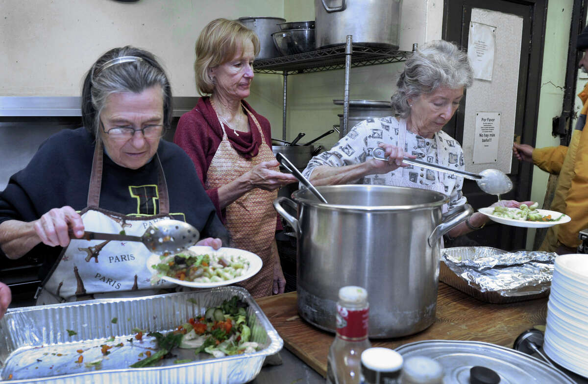 From left, Rita Crimi, Ann Maher and Betty Ballard serve the afternoon meal at the Dorothy Day Hospitality House on Spring Street in Danbury, Tuesday, Nov. 27, 2012.