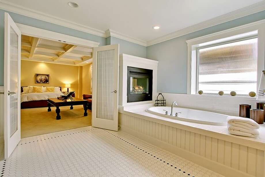Master bathroom of 1414 1st Ave. W., Unit 402. The 2,251-square-foot condo, built in 2004, has three bedrooms and 2.5 bathrooms, coffered ceilings, custom millwork, air conditioning and a balcony. It's listed for $1.225 million. Photo: Courtesy Jan Selvar/Windermere Real Estate