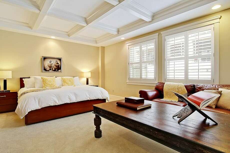 Master bedroom of 1414 1st Ave. W., Unit 402. The 2,251-square-foot condo, built in 2004, has three bedrooms and 2.5 bathrooms, coffered ceilings, custom millwork, air conditioning and a balcony. It's listed for $1.225 million. Photo: Courtesy Jan Selvar/Windermere Real Estate