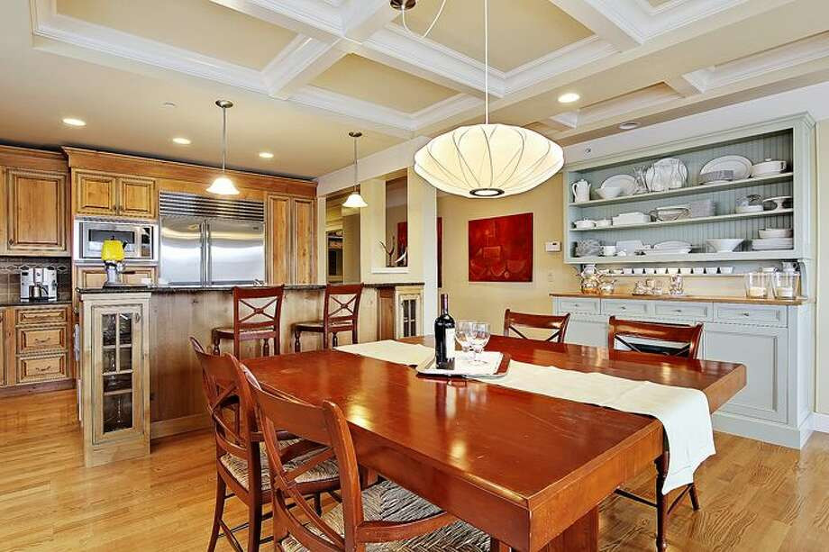 Dining room of 1414 1st Ave. W., Unit 402. The 2,251-square-foot condo, built in 2004, has three bedrooms and 2.5 bathrooms -- including a master suite with a double-sided fireplace, French doors, and his and her closets -- coffered ceilings, custom millwork, air conditioning and a balcony. It's listed for $1.225 million. Photo: Courtesy Jan Selvar/Windermere Real Estate