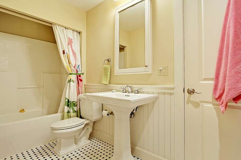 Bathroom of 1414 1st Ave. W., Unit 402. The 2,251-square-foot condo, built in 2004, has three bedrooms and 2.5 bathrooms -- including a master suite with a double-sided fireplace, French doors, and his and her closets -- coffered ceilings, custom millwork, air conditioning and a balcony. It's listed for $1.225 million. Photo: Courtesy Jan Selvar/Windermere Real Estate