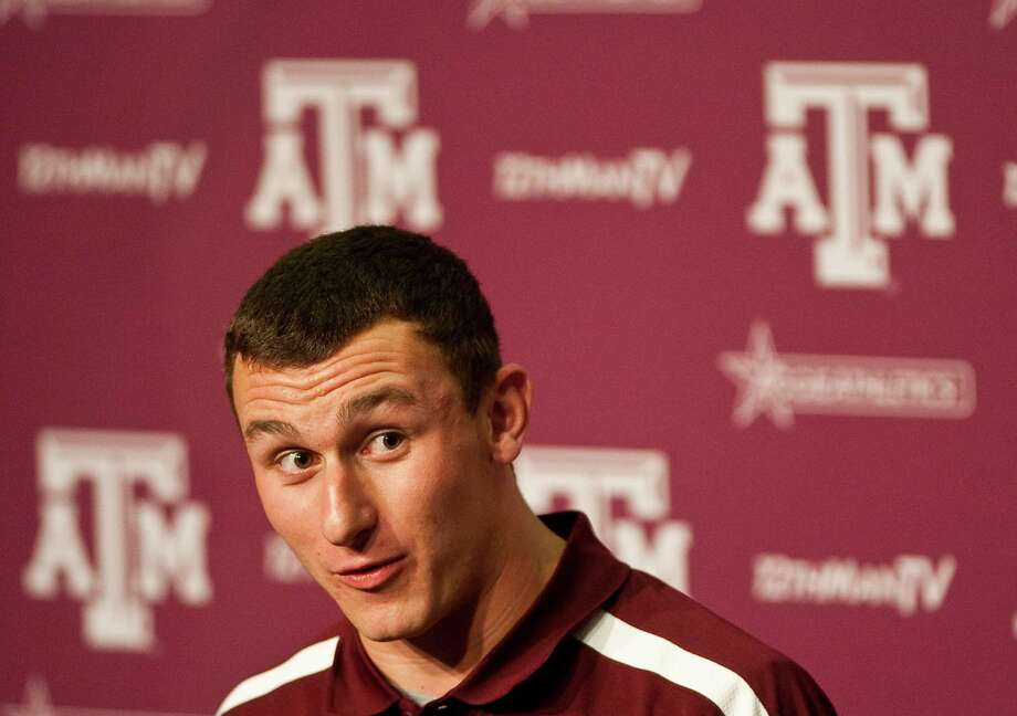 Texas A&M quarterback Johnny Manziel answers questions about his relationship with offensive coordinator Kliff Kingsbury during Manziel's first press conference, Tuesday, Nov. 27, 2012, in the Bright Football Complex on the Texas A&M campus in College Station. Manziel is a candidate for the Heisman Trophy. Photo: Nick De La Torre, Houston Chronicle / © 2012  Houston Chronicle