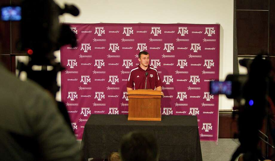 Texas A&M quarterback Johnny Manziel answers questions about his first season as the Aggies starting quarterback during his first press conference, Tuesday, Nov. 27, 2012, in the Bright Football Complex on the Texas A&M campus in College Station. Photo: Nick De La Torre, Houston Chronicle / © 2012  Houston Chronicle