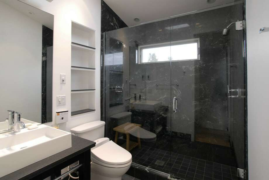 Bathroom of 1417 9th Ave. W., Unit 3. The 2,150-square-foot condo, built in 2005 inside an older home, has two bedrooms, two bathrooms, 16-foot ceilings, a den, a library wall and a wall of windows with views of Puget Sound and the Olympic Mountains. It's listed for $1,300,000. Photo: Courtesy Betty Chandler/Windermere Real Estate