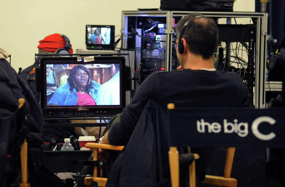 "The image of actress Gabourey Sidibe playing the role of Andrea can be seen on a video monitor during the Showtime television series ""The Big C,"" that was videotaping at the YMCA of Greenwich, Tuesday afternoon, Nov. 27, 2012. Photo: Bob Luckey / Greenwich Time"