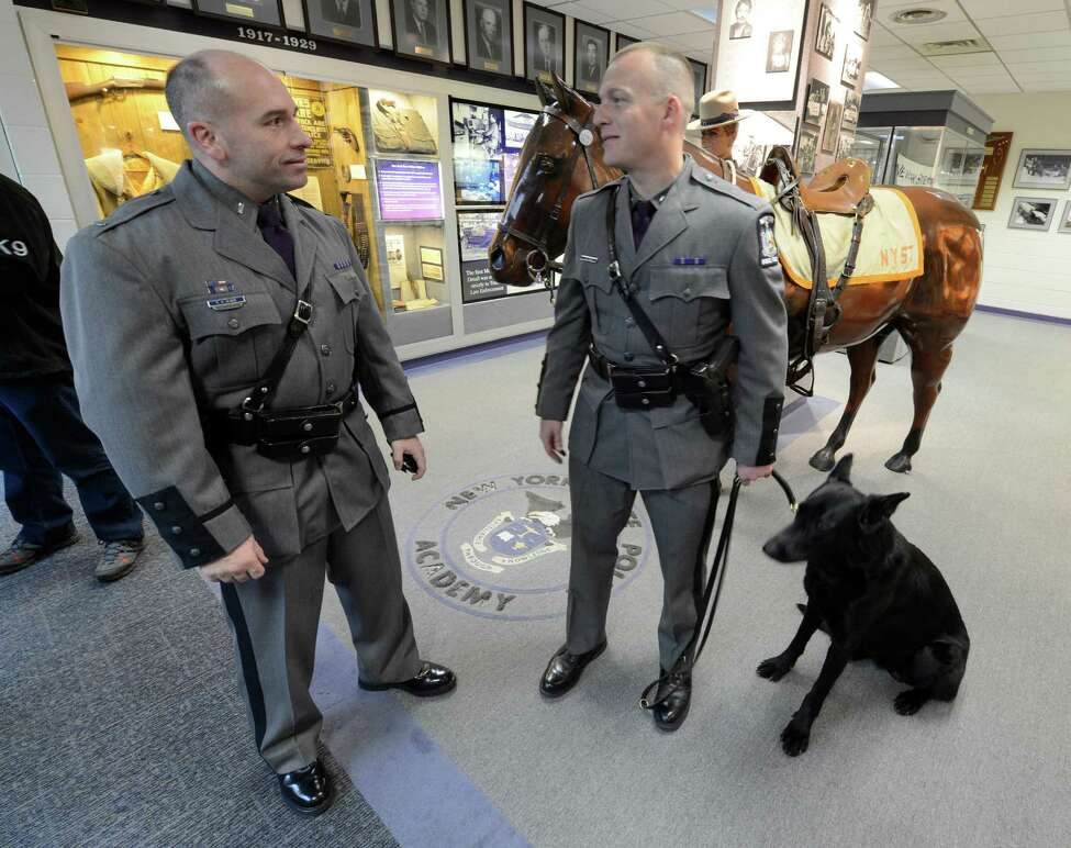 Lt. Anthony Oliver, State Police Capital, left, greets his new K-9 team Trooper Chris White and his partner Renzo after the K-9 graduation ceremony was held at the State Police Academy in Albany, N.Y. Nov 27, 2012. (Skip Dickstein/Times Union)