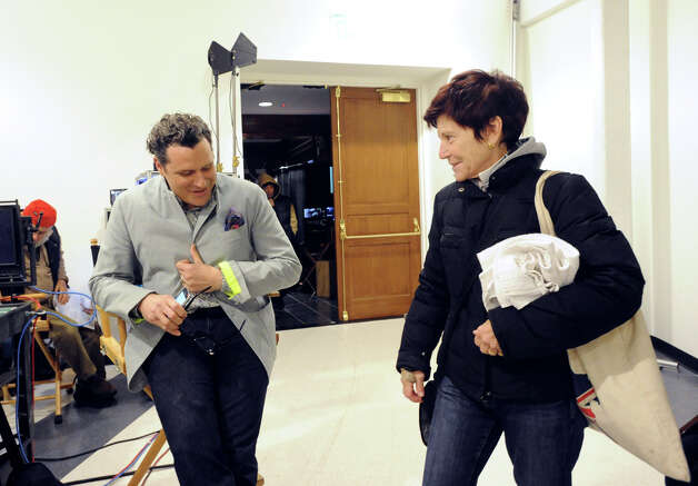 "Fashion designer Isaac Mizrahi, left, gives a bit of fashion mentoring to Greenwich resident, Lynne Jassem, on the set of the Showtime television series ""The Big C,"" that was videotaping at the YMCA of Greenwich, Tuesday afternoon, Nov. 27, 2012. Jassem, a member of the Greenwich YMCA, was passing through the set when she noticed Mizrahi and went over to speask to him ""he's my favorite designer,"" she said. Mizrahi is guest-starring on the show as himself, playing the role of a fashion mentor. Photo: Bob Luckey / Greenwich Time"
