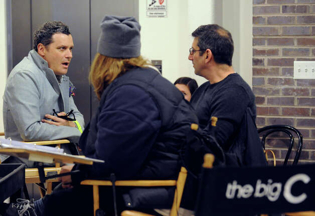"Fashion designer Isaac Mizrahi, left, on the set of the Showtime television series ""The Big C,"" that was videotaping at the YMCA of Greenwich, Tuesday afternoon, Nov. 27, 2012. Mizrahi is guest-starring on the show as himself, playing the role of a fashion mentor. Photo: Bob Luckey / Greenwich Time"