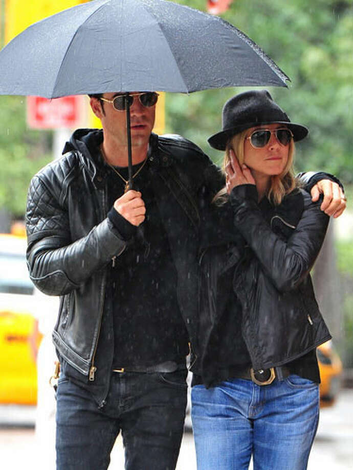 "Justin Theroux and Jennifer Aniston ""So...we did the rocker look today. We're wearing fleece hoodies tomorrow right, Jen?"""