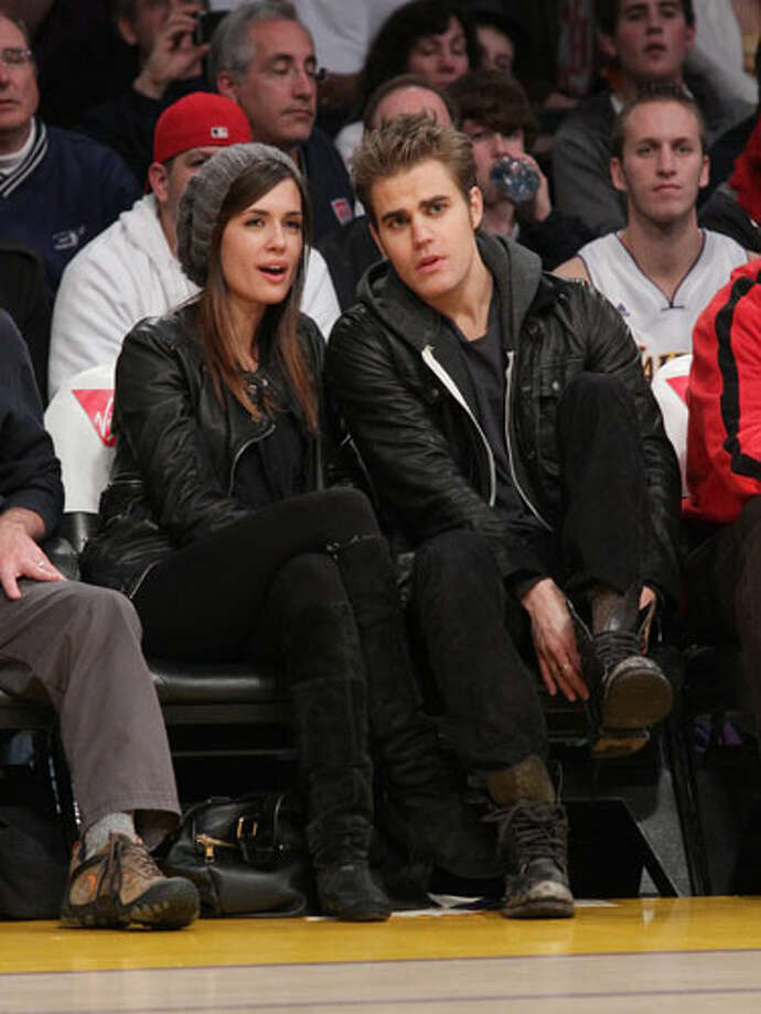Torrey DeVitto and Paul Wesley Paul should have just gone all out and worn a slouchy hat, too.