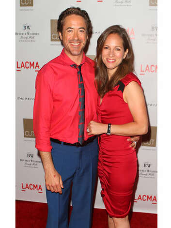 Robert Downey Jr and Susan Downey Thank god Susan has a little black on her dress. Otherwise, they wouldn't match at all.