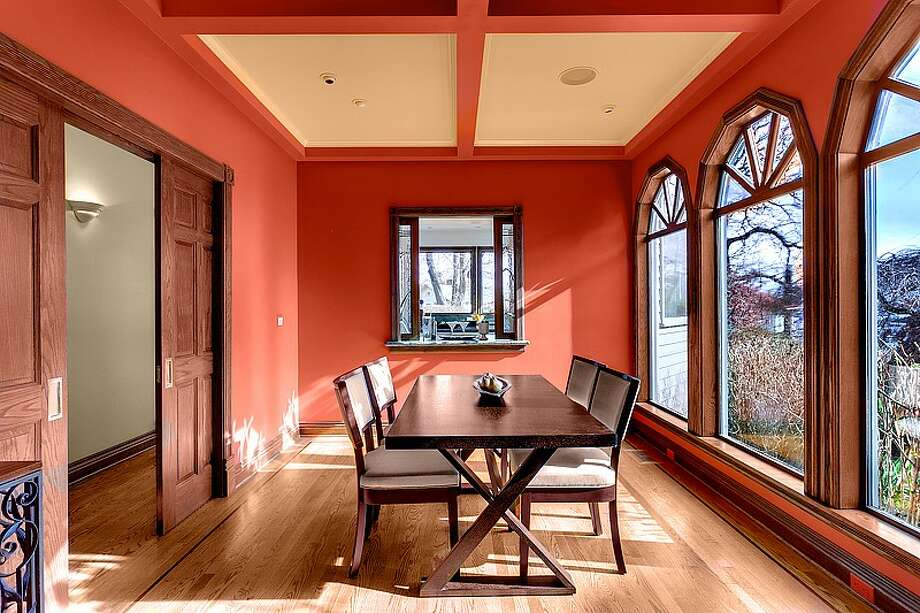 Dining room of 1210 3rd Ave. N. The 4,535-square-foot house, built in 1991, has five bedrooms and 4.5 bathrooms -- including a master suite with four skylights -- a marble entry, coffered ceilings, exposed-wood doors and moldings, French and pocket doors, a media room, a marble spa, a sauna and a deck with views of the Seattle skyline. It's listed for $1.299 million. Photo: Courtesy Jeffrey Valcik/Windermere Real Estate