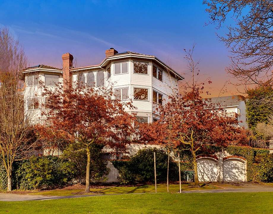 We'll end with 1210 3rd Ave. N. The 4,535-square-foot house, built in 1991, has five bedrooms and 4.5 bathrooms -- including a master suite with four skylights -- a marble entry, coffered ceilings, exposed-wood doors and moldings, French and pocket doors, a media room, a marble spa, a sauna and a deck with views of the Seattle skyline. It's listed for $1.299 million. Photo: Courtesy Jeffrey Valcik/Windermere Real Estate